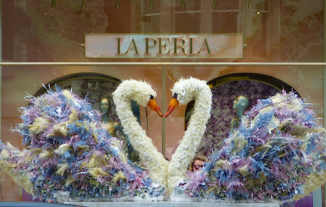 Floral swans on Sloane Street, London, for Chelsea in Bloom 2018 free flower festival