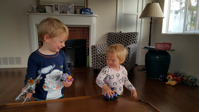 toddlers-opening-presents-small-vehicles