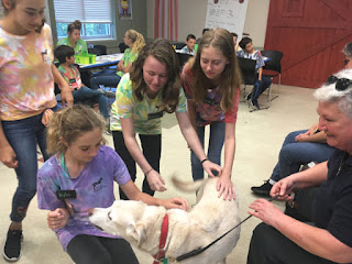 Audrey and Jessie visit with kids at Bark Camp.