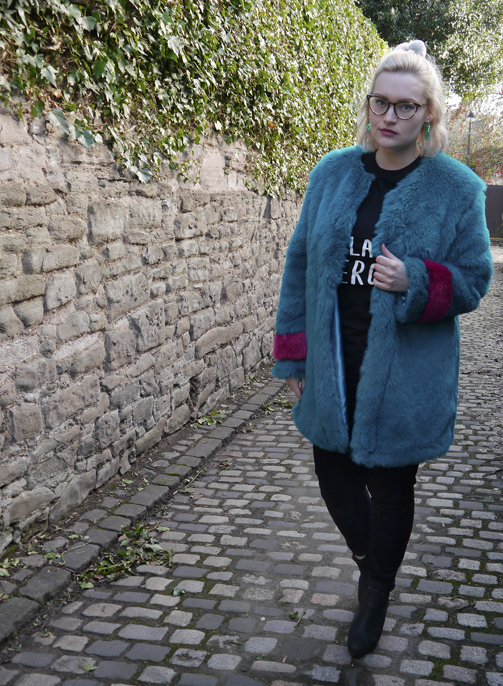 UK street style with oversized turquoise and purple faux fur jacket