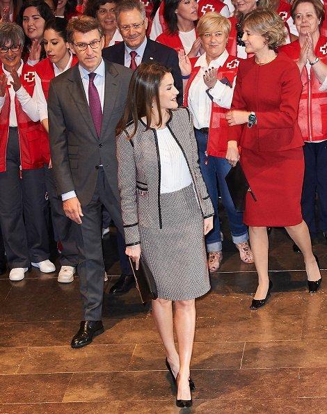 Queen Letizia wore Hugo Boss Keili Jacket and Meili Skirt, and wore Carolina Herrera black patent and suede pumps, and carried Carolina Herrera clutch