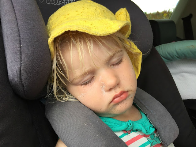 Tin Box Tot asleep in  the car