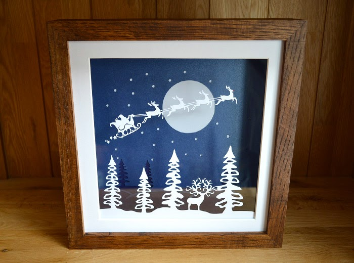 Father Christmas riding reindeer in the moonlight christmas papercutting