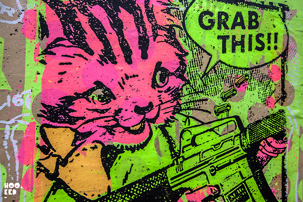 Cat with gun, Brick Lane Street Art Paste-ups in London by artist Zombiesqueegee