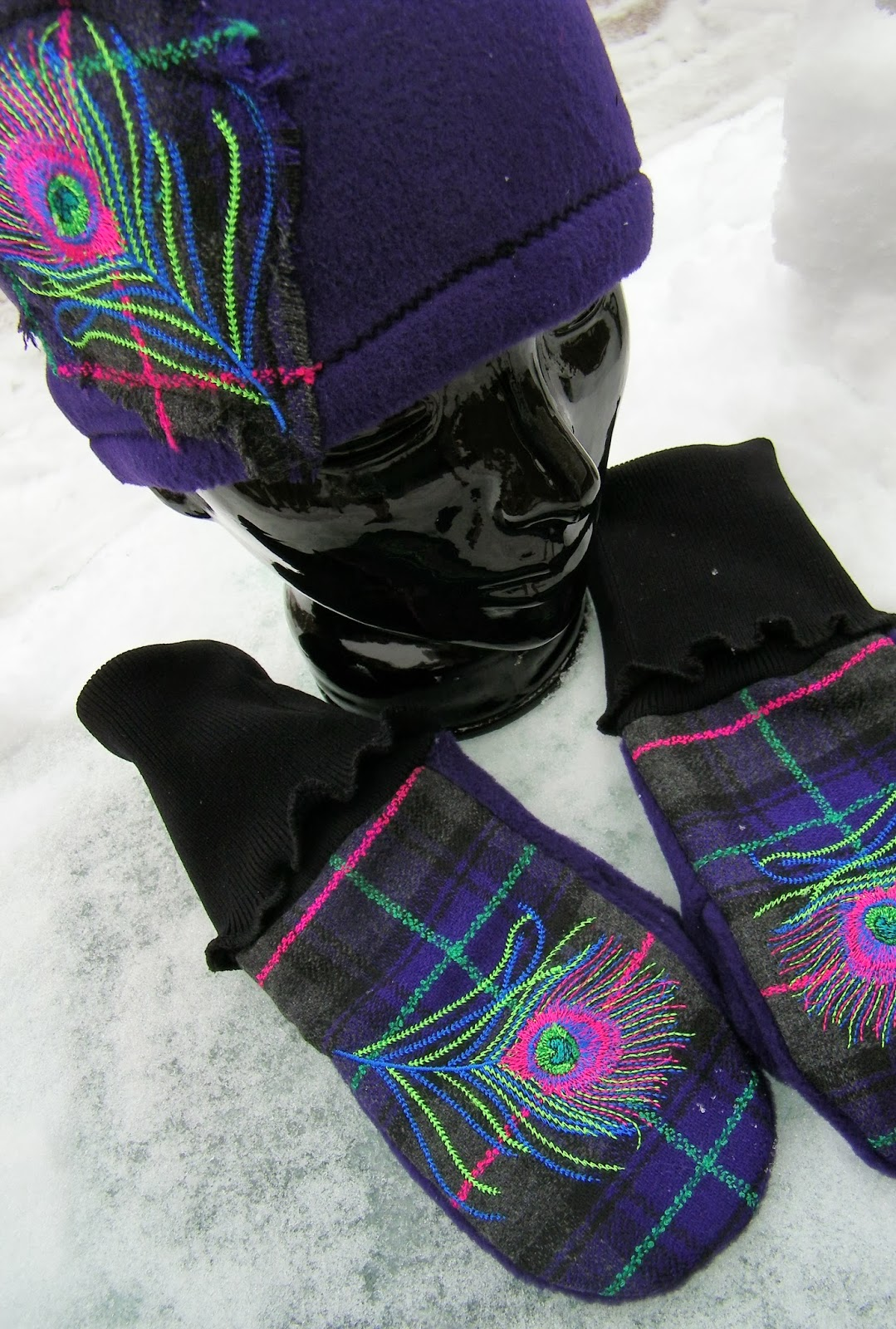 The peacock feather really shines on these wonderful mittens and matching hat from Carolyn Cagle's Strikke Knits!