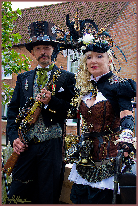 Classy steampunk couple (man and woman) in matching/coordinating steampunk clothing. Steampunk couples costumes