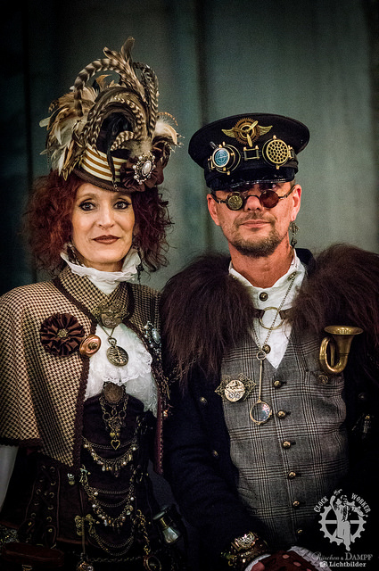 Steampunk couple in beautiful fabrics and accessories. Clothing and fashion for men and women