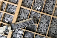 wooden tray filled with movable type