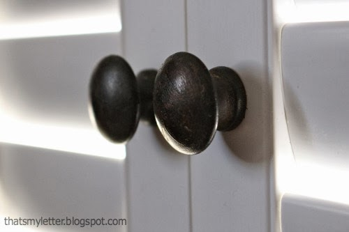 wood knobs on white shutters