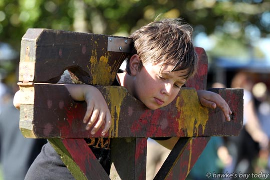 Sam van der Zwet, 10, Taradale, in the village stocks - Much Ado about Nothing, at Shakespeare in the Park, at Church Rd Winery, Taradale, Napier. photograph