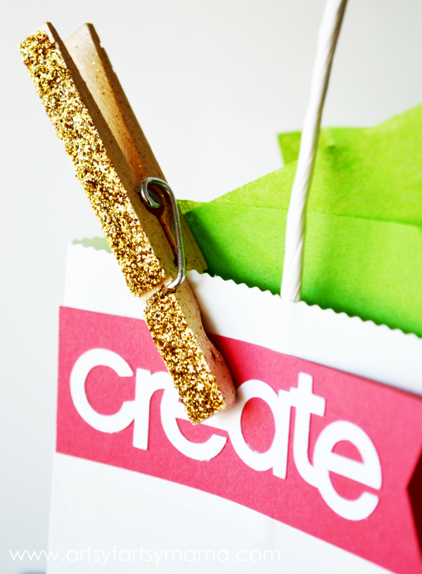 DIY Glittered Clothespins look cute on gift bags! Tutorial from artsyfartsymama.com #glitter #clothespins