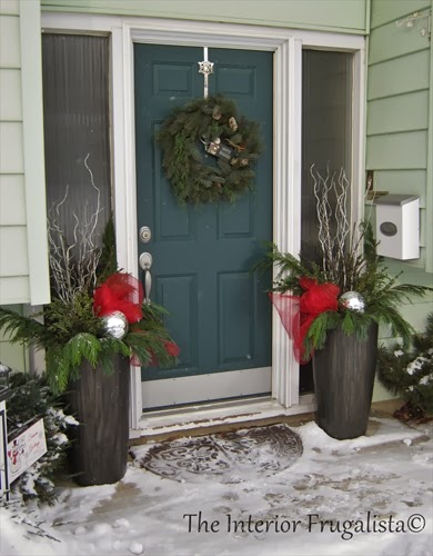 Pretty outdoor planters flanking the front door during the holidays