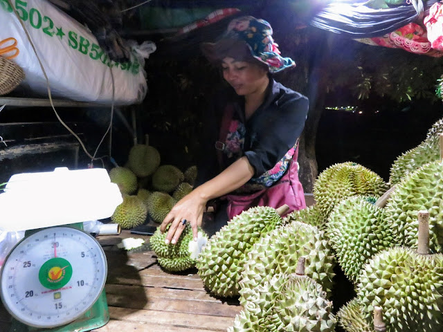 Cutting a durian in Siem Reap Cambodia