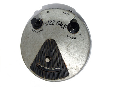 "Image of the top view of a vintage ""fuzz face"" pedal"
