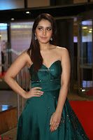 Raashi Khanna in Dark Green Sleeveless Strapless Deep neck Gown at 64th Jio Filmfare Awards South ~  Exclusive 089.JPG