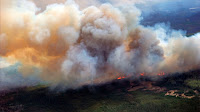 A Canadian Joint Operations Command aerial photo shows wildfires in Fort McMurray, Alberta, Canada in this image posted on twitter May 5, 2016. (Credit: CF Operations/Handout via Reuters) Click to Enlarge.