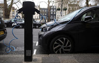 Electric cars are plugged into a charging point in London, Britain, April 7, 2016. (Credit: Reuters/Neil Hall/File Photo) Click to Enlarge.