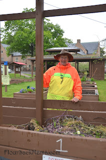 gardener at compost bins