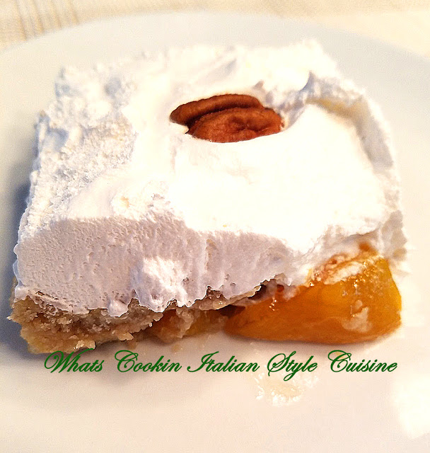 this is an easy dessert using a cake mix and pie filling call dump cake with whipped cream this cake is butter pecan with peaches
