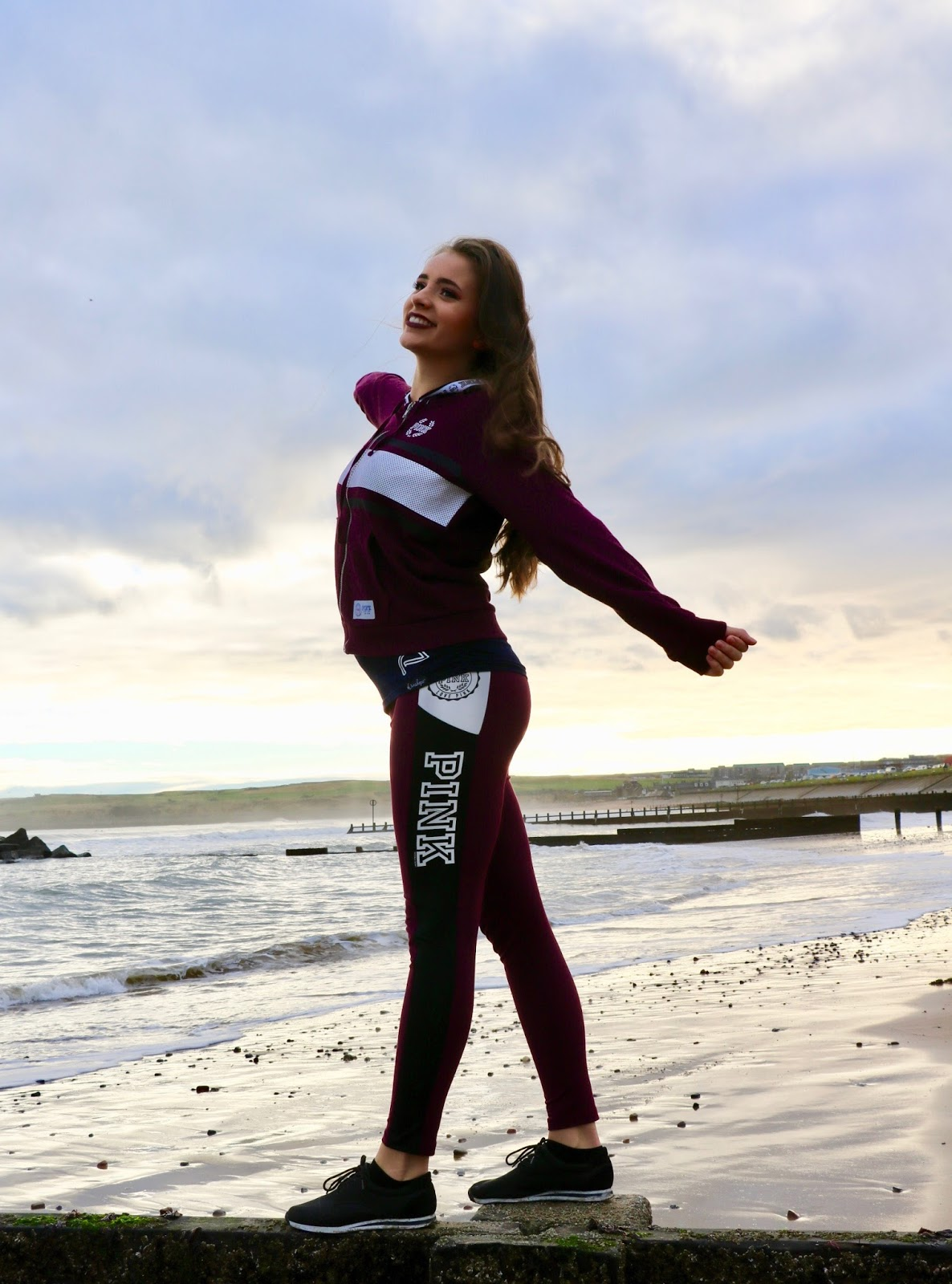 Girl in sports wear on Aberdeen beach
