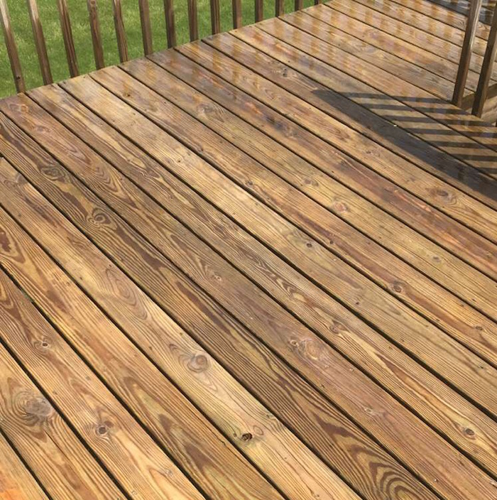 this is what the deck looked like wet after it was cleaned and i could definitely notice the difference once it dried however it went back to how it - Behr Semi Transparent Stain Colors