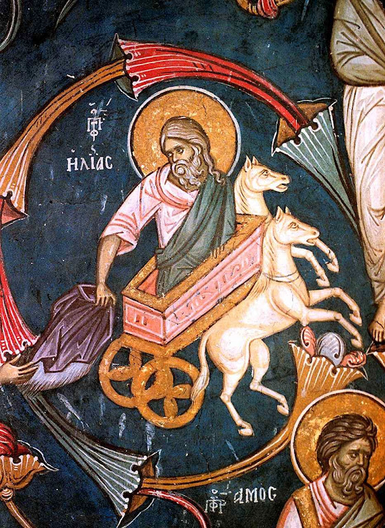 O profeta Elias, fundador do Carmo, parte num carro de fogo para um local misterioso mas deixa seu manto a São Eliseu.