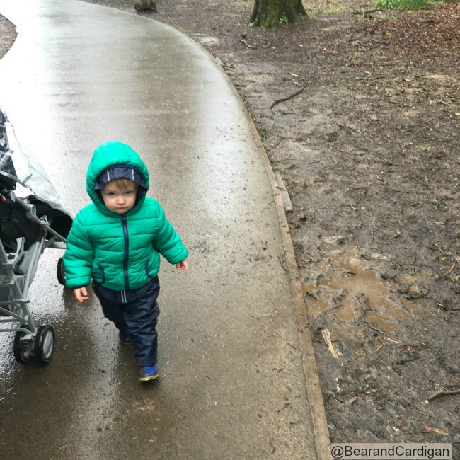 Toddler walking away with a not happy face