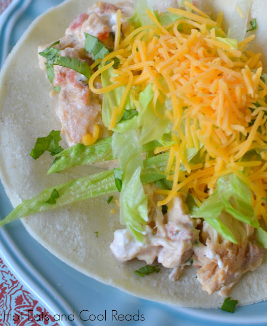 Easy crock pot meal that's also great for burritos, tostadas, taco salad or nachos! So delicious! Slow Cooker Creamy Chicken Tacos Recipe from Hot Eats and Cool Reads