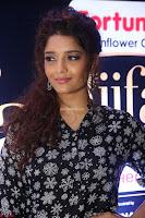 Ritika Singh in Black Printed Shirt and White Leggings at IIFA Utsavam Awards press meet 27th March 2017 09.JPG
