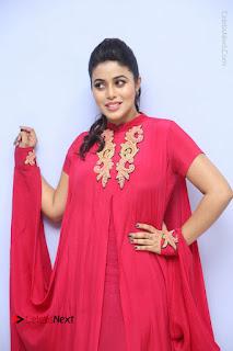 Actress Poorna Latest Stills in Red Dress at Rakshasi First Look Launch  0076.JPG
