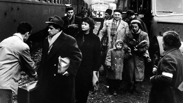 Hungarian refugees in 1956 boarding a train for Austria