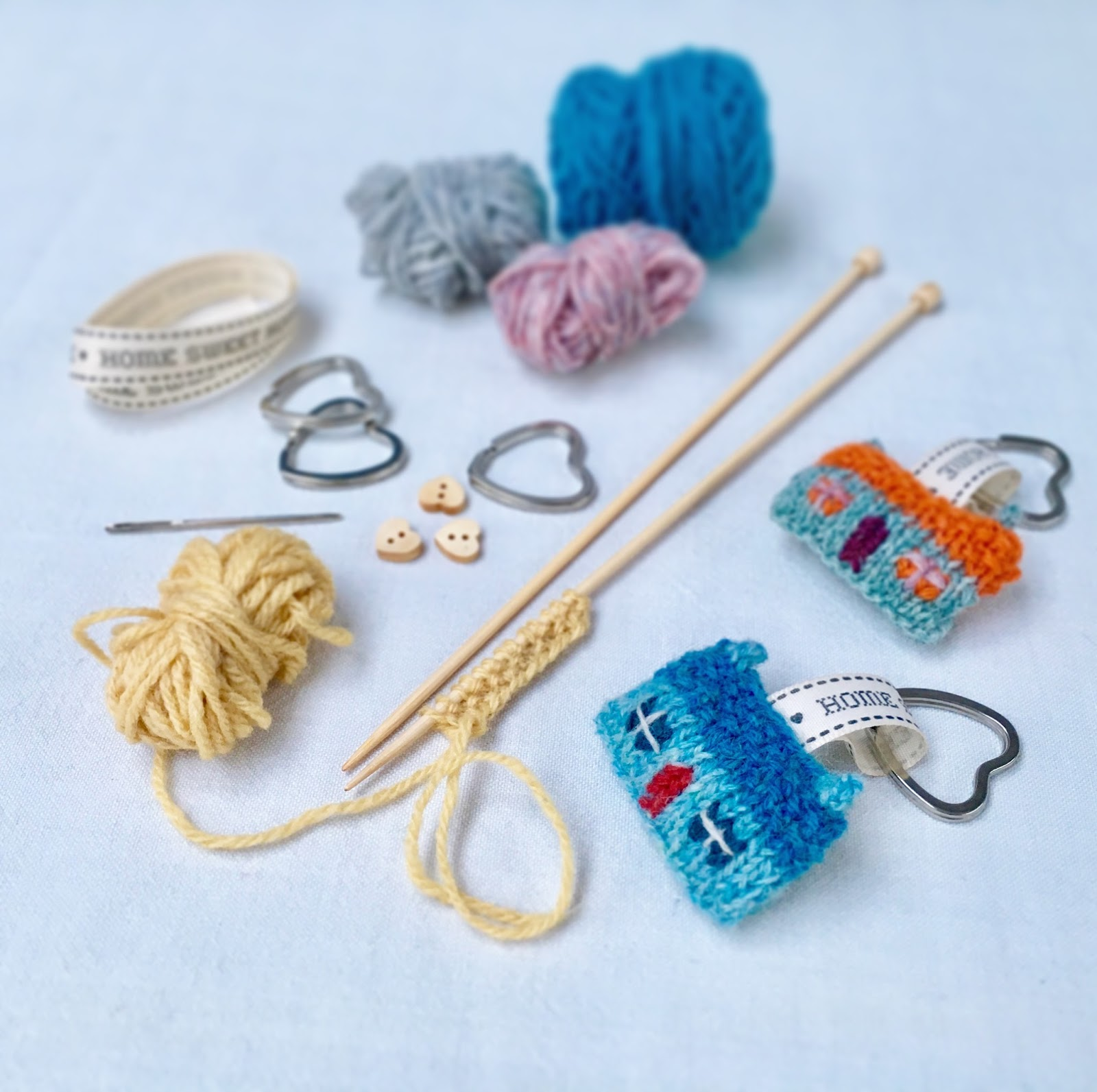 things has slightly key gift brooch on differently knitting and knitted needles the tiny similar been with are embellishments in sewn design constructed underway rings straight img hand but