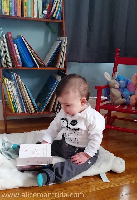 baby reading a book, nursery, baby boy, baby's first bedroom, bookshelf, children's room, kid's room, play room