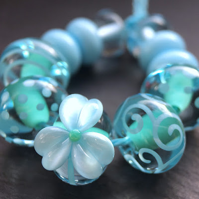 Handmade lampwork glass beads by Laura Sparling