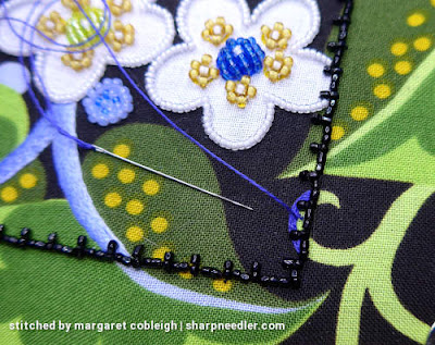 Using blue embroidery thread to cover a green element and make it disappear. (Wild Child Japanese Bead Embroidery by Mary Alice Sinton)