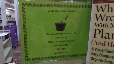 Sign advertising the plant clinic at Davis Library