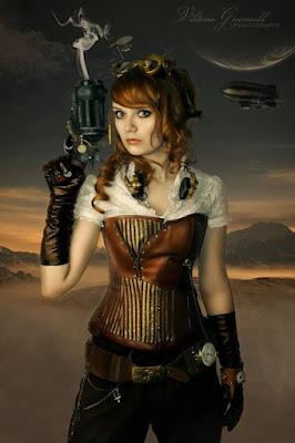 Example of Overbust Corset used in Steampunk fashion. This woman is wearing her overbust corset with a blouse, pants, belt, gloves, goggles and headphones.