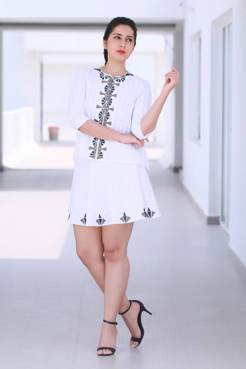 Tollywood Glamours Hot Rashi Khanna Legs Show Photo shoot In White Mini Skirt