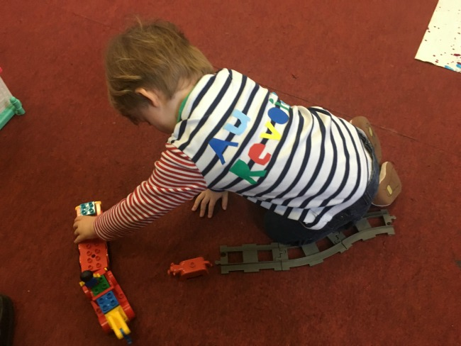 toddler-playing-with-toy-train