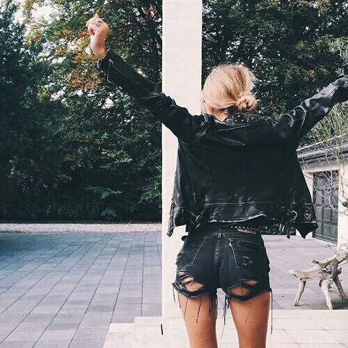 a leather jacket with bandits jean short