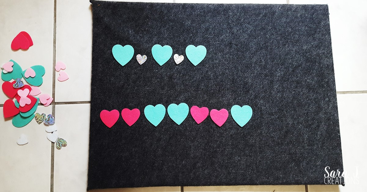 Basic math practice for toddlers and preschoolers using felt hearts to make learning fun and hands on,