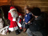 Mummy, Daddy and son looking at Santa