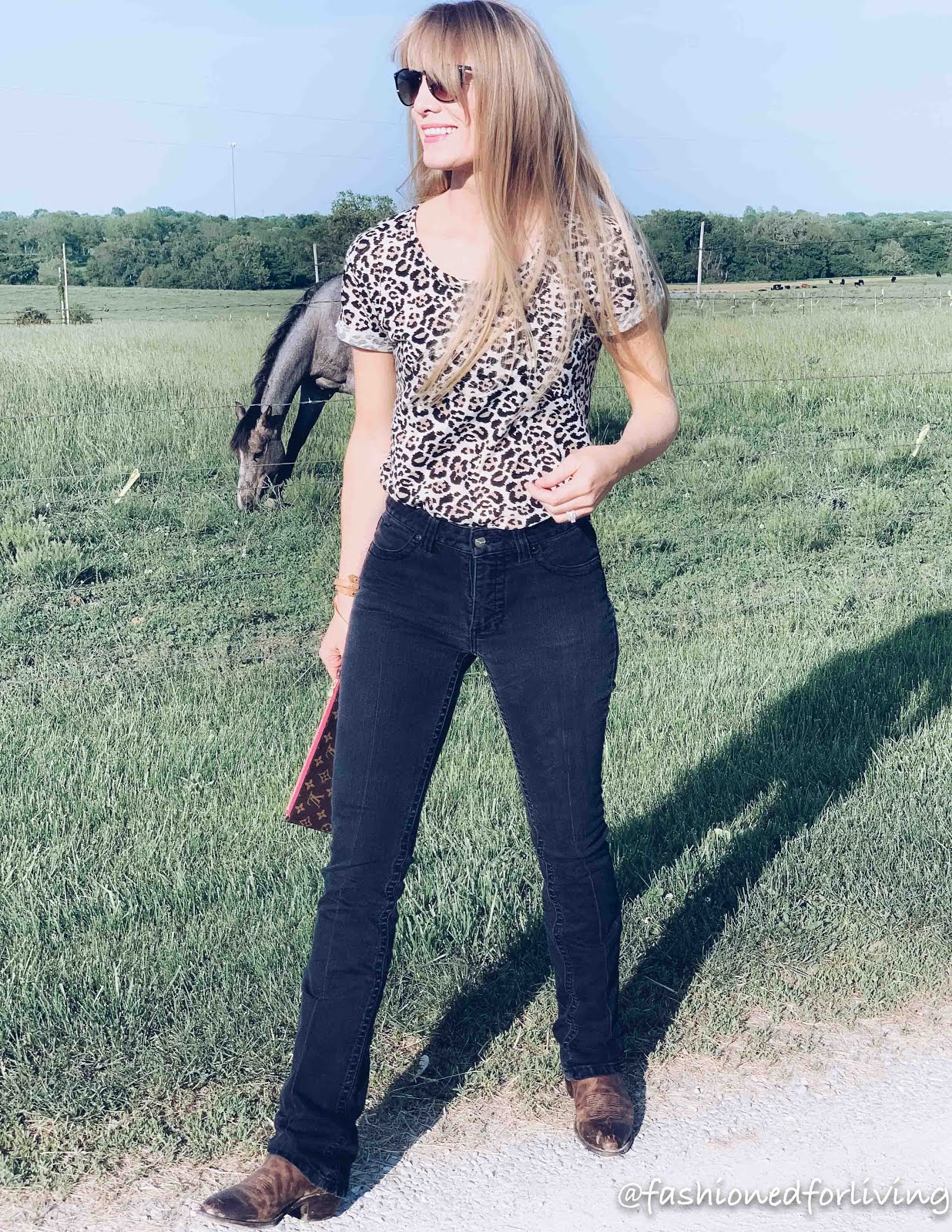 kimes betty jeans outfit with leopard tee. cowgirl boots.