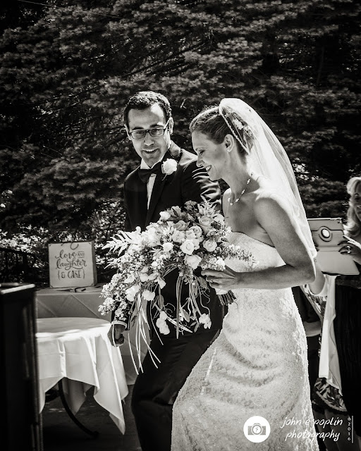 a photograph of a bride and groom walking to the alter for their wedding ceremony