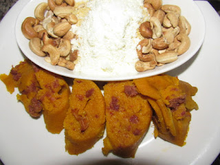 Corned beef moi moi served with garri and nuts and milk
