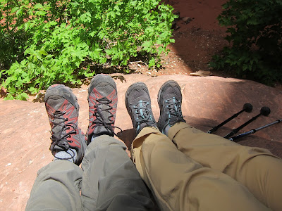 Picture of two pairs of hiking boots on a rock in Zion National Park