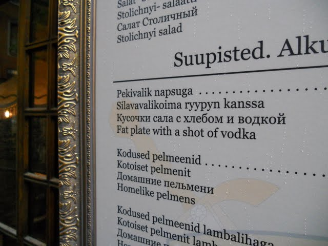 Menu featuring a  'fat plate with a shot of vodka' in Tallinn, Estonia