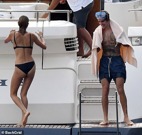 Justin Bieber and Hailey Baldwin pack on the PDA aboard a luxury yacht in Italy