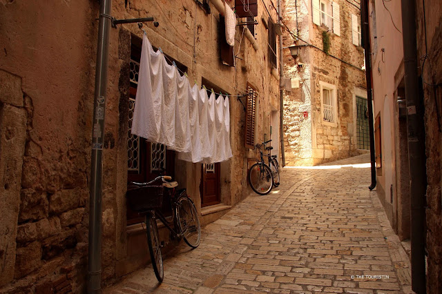 Rovinj, Croatia, Europe, old town. Washing line, bike, cobbled streets.