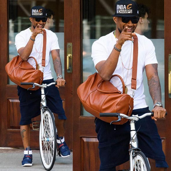 """Cleveland Cavaliers owner Usher Raymond spotted riding a bicycle with """"2016 NBA champs"""" cap"""